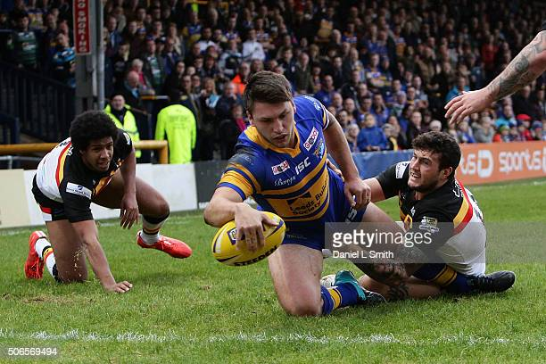 Tom Briscoe of Leeds Rhinos breaks through a tackle from Jay Pitts of Bradford Bulls and crosses over to score his side a try during the Leeds Rhinos...