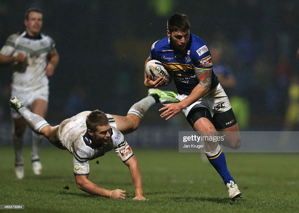 Tom Briscoe of Leeds Rhinos holds off Rhys Hanbury of Widnes Vikings for a try during the First Utility Super League match between Leeds Rhinos and Widnes Vikings at Headingley Carnegie Stadium on February 13, 2015 in Leeds, England.