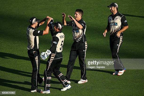 Tom Bruce Ben Wheeler Luke Ronchi and Colin de Grandhomme celebrate the wicket of Tamim Iqbal of Bangladesh during the first Twenty20 match between...