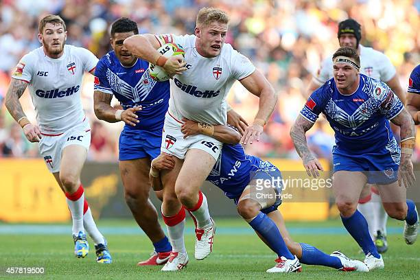 Tom Burgess of England is tackled during the Four Nations match between England and Samoa at Suncorp Stadium on October 25 2014 in Brisbane Australia