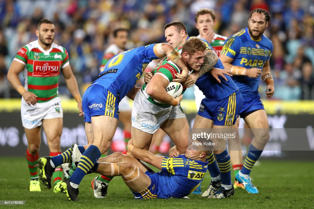 Tom Burgess of the Rabbitohs is tackled during the round 26 NRL match between the Parramatta Eels and the South Sydney Rabbitohs at ANZ Stadium on September 1, 2017 in Sydney, Australia.