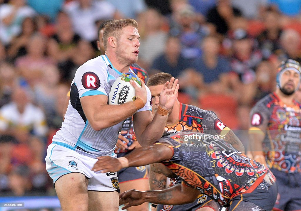 Tom Burgess of the World All Stars takes on the defence during the NRL match between the Indigenous All-Stars and the World All-Stars at Suncorp Stadium on February 13, 2016 in Brisbane, Australia.