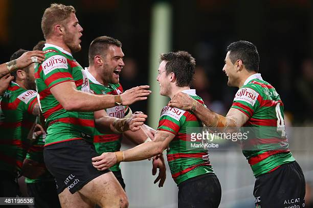 Tom Burgess Tim Grant Adam Reynolds and Bryson Goodwin of the Rabbitohs celebarte after 7 scored a try during the round 19 NRL match between the St...