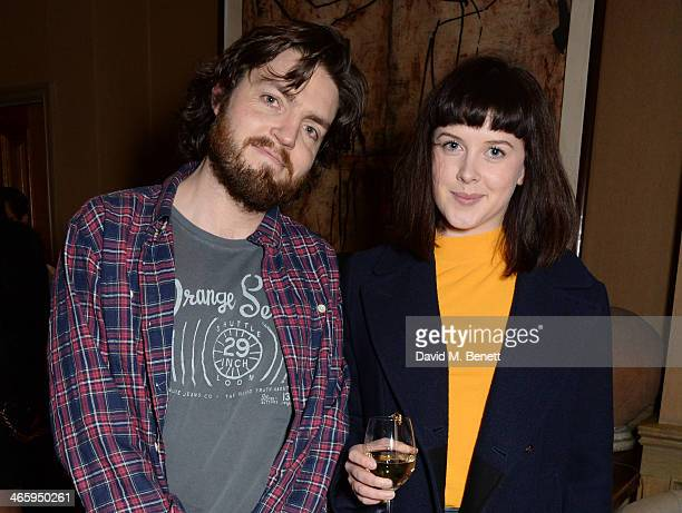 Tom Burke and Alexandra Roach attend a drinks reception and private screening of BAFTA and Oscar nominated film 'Philomena' hosted by Harvey...