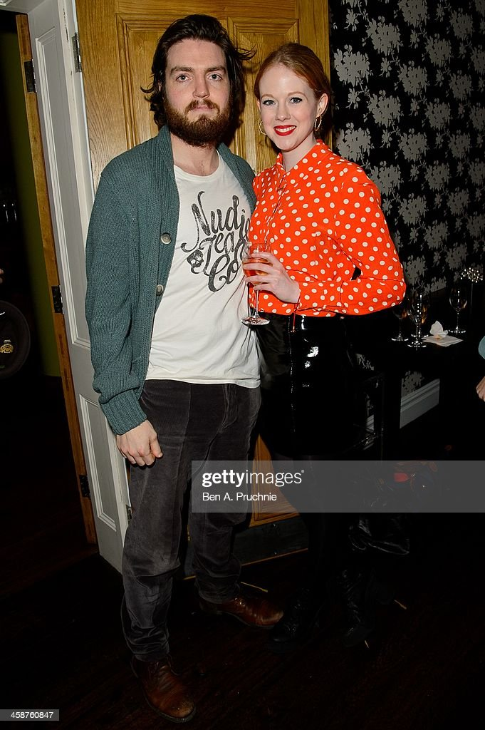 Tom Burke and Zoe Boyle attend the August: Osage County drinks & screening at Soho Hotel on December 21, 2013 in London, England.