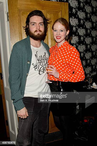 Tom Burke and Zoe Boyle attend the August Osage County drinks screening at Soho Hotel on December 21 2013 in London England