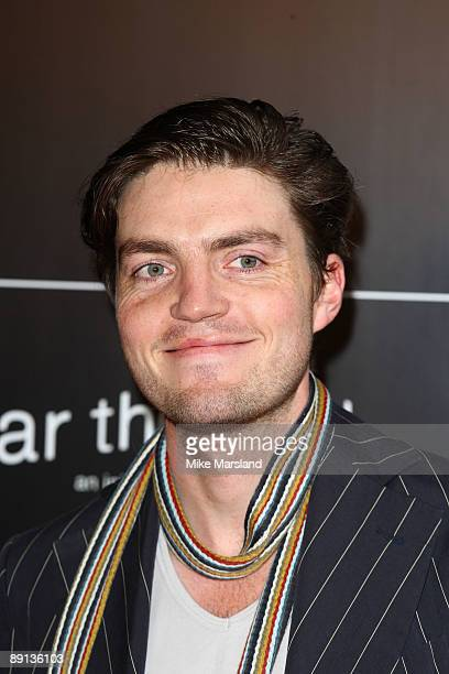Tom Burke attends Bryan Adams 'Hear The World Ambassadors' exhibition at Saatchi Gallery on July 21 2009 in London England