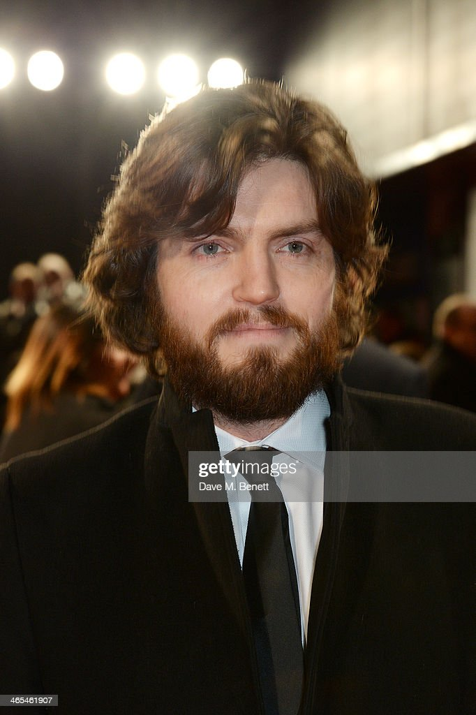 Tom Burke attends the UK Premiere of 'The Invisible Woman' at the ODEON Kensington on January 27, 2014 in London, England.