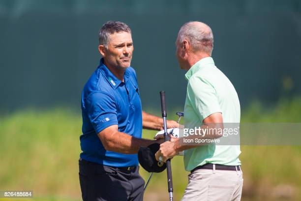 Tom Byrum and Gary Hallberg shake hands after finishing their round during the First Round of the 3M Championship at TPC Twin Cities on August 4 2017...