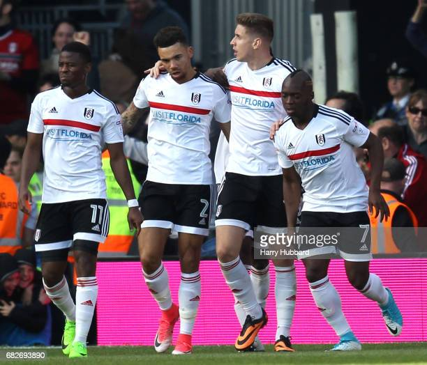 Tom Cairney of Fulham celebrates scoring his sides first goal with his Fulham team mates during the Sky Bet Championship Play off semi final 1st leg...