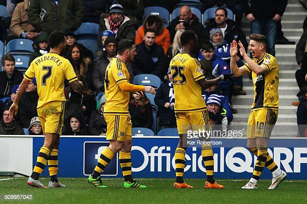 Tom Cairney of Fulham celebrates scoring the third goal with fellow goalscorers Moussa Dembele and Ross McCormack during the Sky Bet Championship...