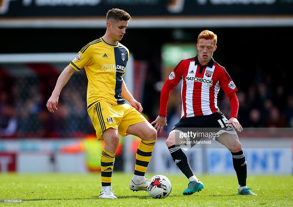 Tom Cairney of Fulham under pressure from Ryan Woods of Brentford during the Sky Bet Championship match between Brentford and Fulham at Griffin Park on April 30, 2016 in Brentford, England.