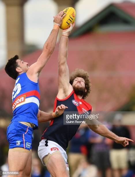 Tom Campbell of the Bulldogs and Jake Spencer of the Demons compete in the ruck during the 2017 JLT Community Series match between the Western...