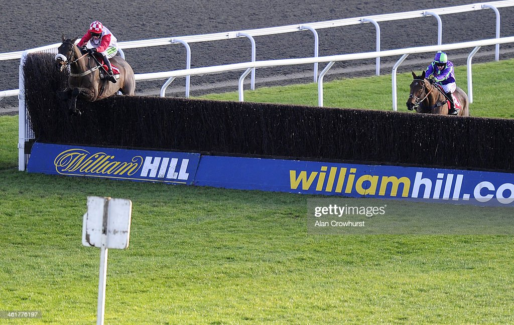 Tom Cannon riding King Edmund clear the last to win The William Hill - Download The App Handicap Steeple Chase at Kempton Park racecourse on January 11, 2014 in Sunbury, England.