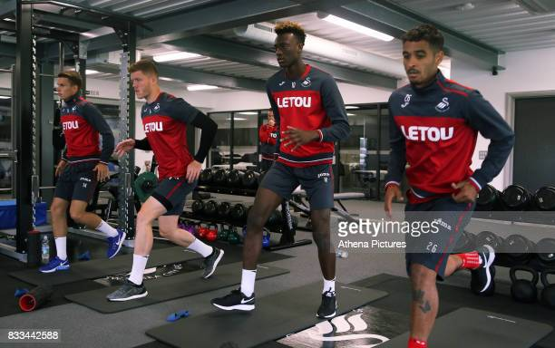 Tom Carroll Alfie Mawson Tammy Abraham and Kyle Naughton exercise in the gym during the Swansea City Training at The Fairwood Training Ground on...