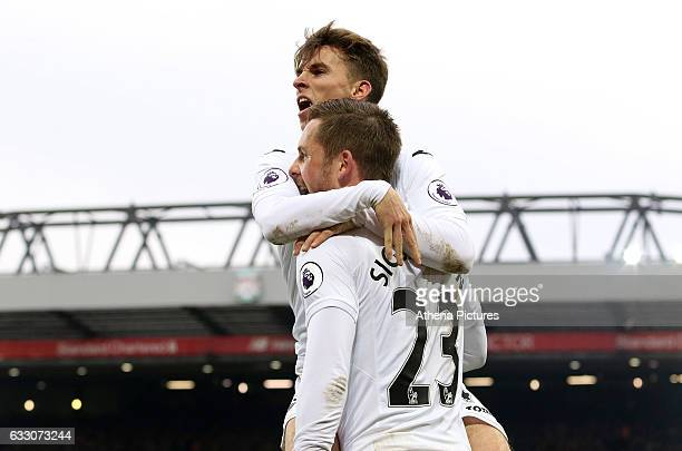 Tom Carroll and Gylfi Sigurðsson of Swansea City celebrates scoring his sides third goal of the match during the Premier League match between...