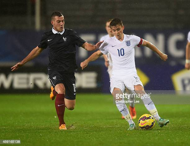 Tom Carroll of England battles with Jordan Veretout of France during the U21 International Friendly match between France and England at the Stade...