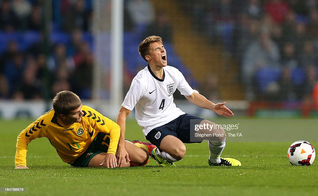 <a gi-track='captionPersonalityLinkClicked' href=/galleries/search?phrase=Tom+Carroll&family=editorial&specificpeople=850381 ng-click='$event.stopPropagation()'>Tom Carroll</a> (R) of England is challenged by Tomas Birskys of Lithuania during the 2015 UEFA European U21 Championships Qualifying Group One match between England U21 and Lithuania U21 at Portman Road on October 15, 2013 in Ipswich, England.