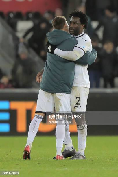 Tom Carroll of Swansea City and team mate Wilfried Bony embrace at the end of the game during the Premier League match between Swansea City and West...