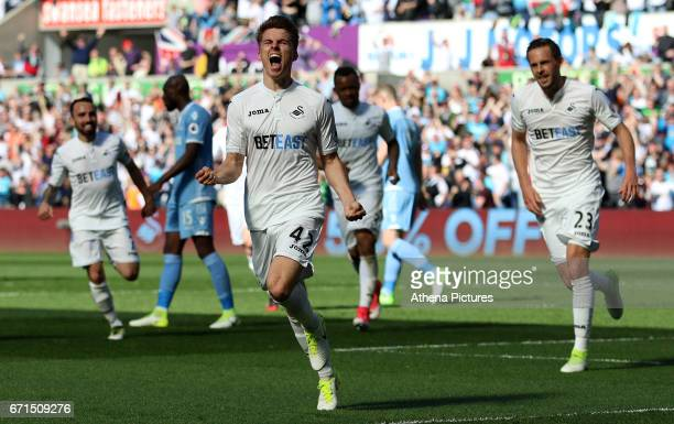 Tom Carroll of Swansea City celebrates scoring his side's second goal of the match during the Premier League match between Swansea City and Stoke...