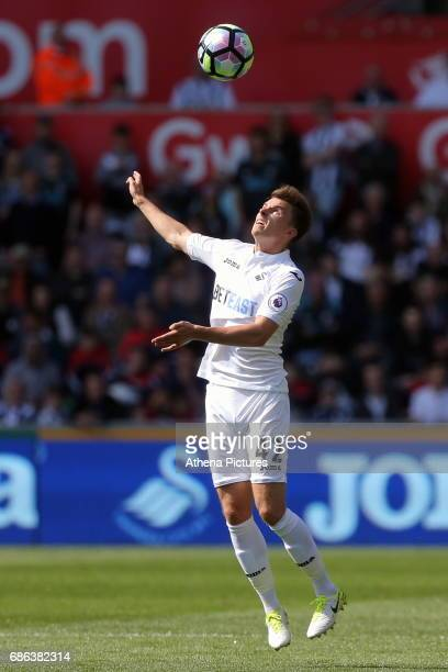 Tom Carroll of Swansea City controls the ball with a header during the Premier League match between Swansea City and West Bromwich Albion at The...