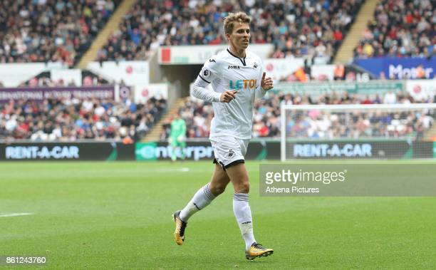 Tom Carroll of Swansea City in action during the Premier League match between Swansea City and Huddersfield Town at The Liberty Stadium on October 14...