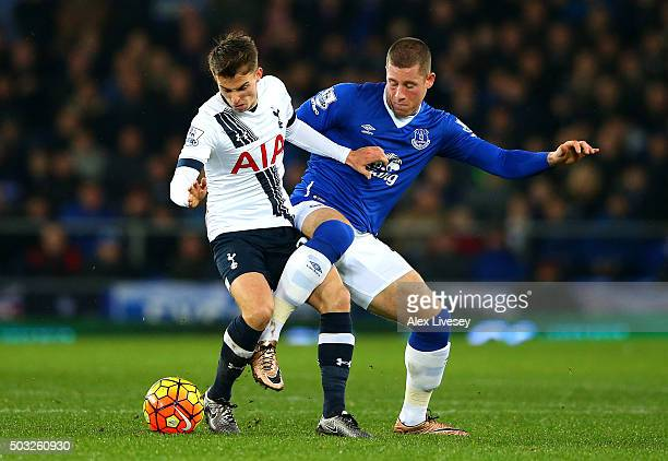 Tom Carroll of Tottenham Hotspur battles for the ball with Ross Barkley of Everton during the Barclays Premier League match between Everton and...