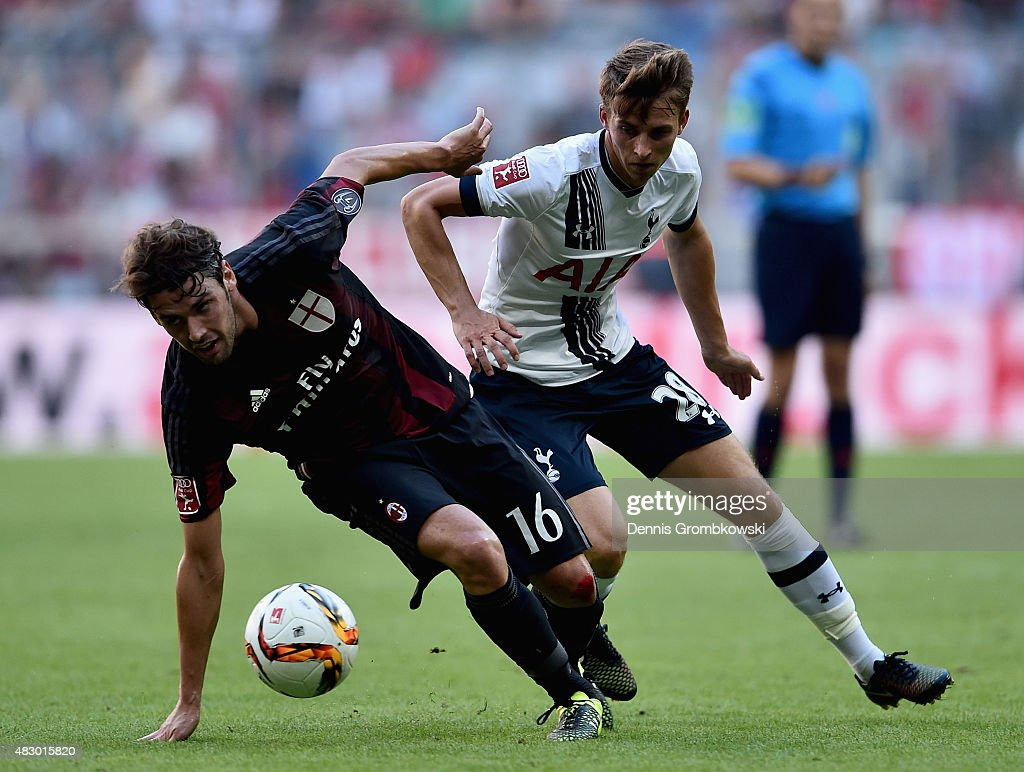 <a gi-track='captionPersonalityLinkClicked' href=/galleries/search?phrase=Tom+Carroll&family=editorial&specificpeople=850381 ng-click='$event.stopPropagation()'>Tom Carroll</a> of Tottenham Hotspur challenges <a gi-track='captionPersonalityLinkClicked' href=/galleries/search?phrase=Andrea+Poli&family=editorial&specificpeople=4520865 ng-click='$event.stopPropagation()'>Andrea Poli</a> of AC Milan during the Audi Cup 2015 match between Tottenham Hotspur and AC Milan at Allianz Arena on August 5, 2015 in Munich, Germany.