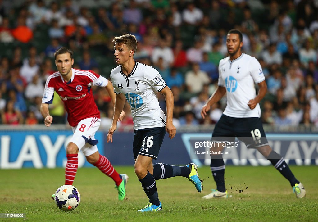 <a gi-track='captionPersonalityLinkClicked' href=/galleries/search?phrase=Tom+Carroll&family=editorial&specificpeople=850381 ng-click='$event.stopPropagation()'>Tom Carroll</a> of Tottenham Hotspur runs with the ball during the Third Place Play-Off match between Tottenham Hotspur and South China at Hong Kong Stadium on July 27, 2013 in So Kon Po, Hong Kong.