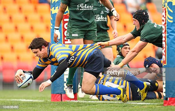 Tom Carter of Sydney Uni scores a try during the Shute Shield Grand Final match between Randwick and Sydney University at Concord Oval on October 2...