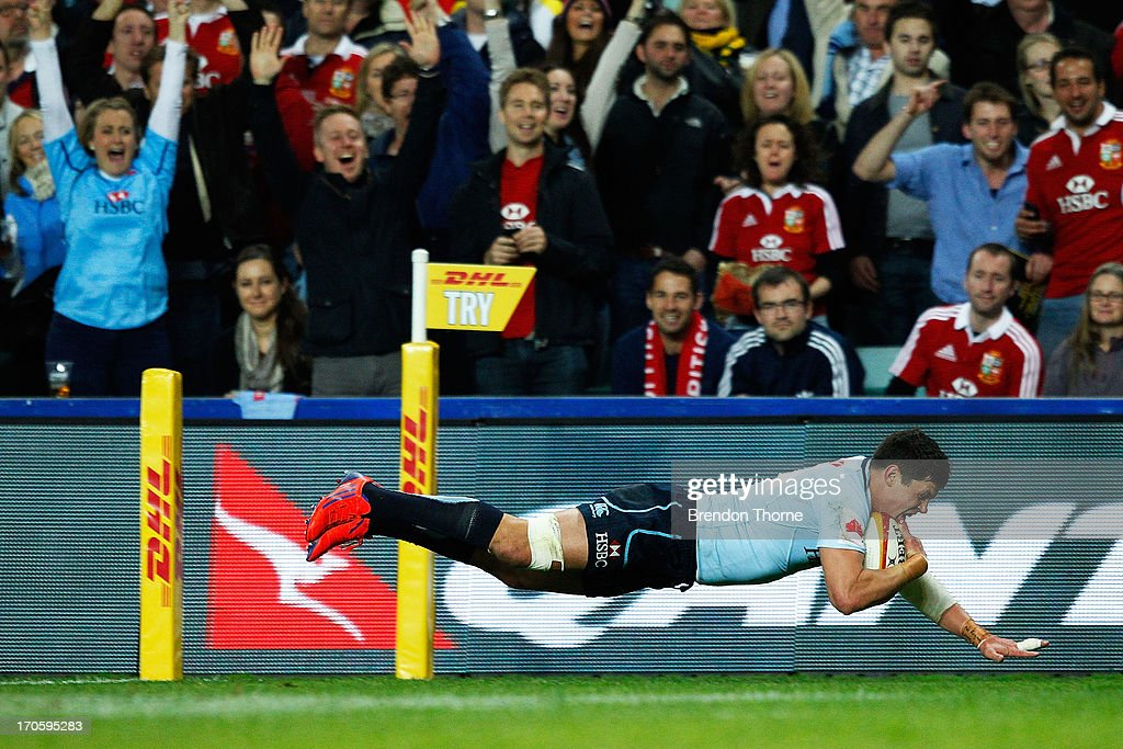 Tom Carter of the Waratahs dives to score a try during the match between the NSW Waratahs and the British & Irish Lions at Allianz Stadium on June 15, 2013 in Sydney, Australia.