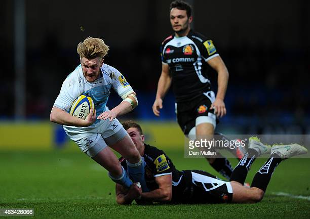 Tom Catterick of Newcastle Falcons is tackled by Henry Slade of Exeter Chiefs during the Aviva Premiership match between Exeter Chiefs and Newcastle...