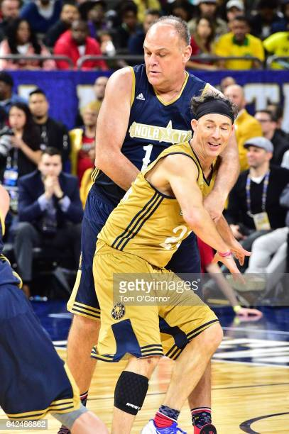 Tom Cavanagh of the West team defends Oscar Schmidt of the East team during the 2017 NBA AllStar Celebrity Game as part of 2017 AllStar Weekend at...