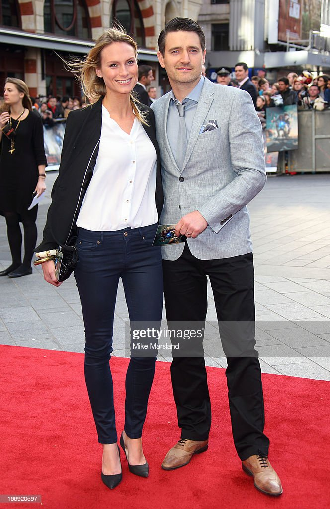 Tom Chambers and Clare Harding attend a special screening of 'Iron Man 3' at Odeon Leicester Square on April 18, 2013 in London, England.