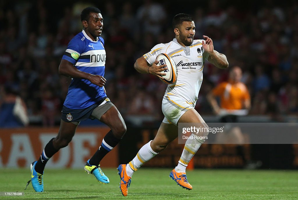 Tom Chapman of Worcester Warriors breaks with the ball to score a try against Bath during the J.P. Morgan Asset Management Premiership Rugby 7's held at Kingsholm Stadium on August 1, 2013 in Gloucester, England.