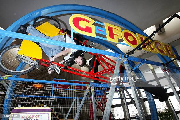Tom Charabin 16 of Toronto rides the G Force in the great hall of the Ontario Science Centre The G Force allows the rider to safely experience the G...