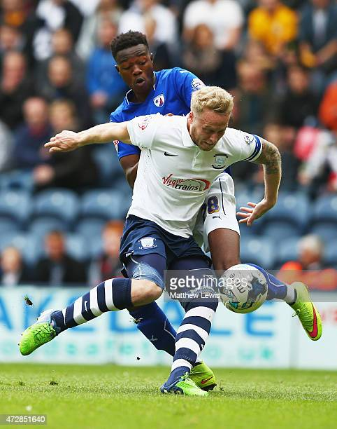 Tom Clarke of Preston North End holds of Gboly Ariyibi of Chesterfield during the Sky Bet League One Playoff SemiFinal second leg match between...