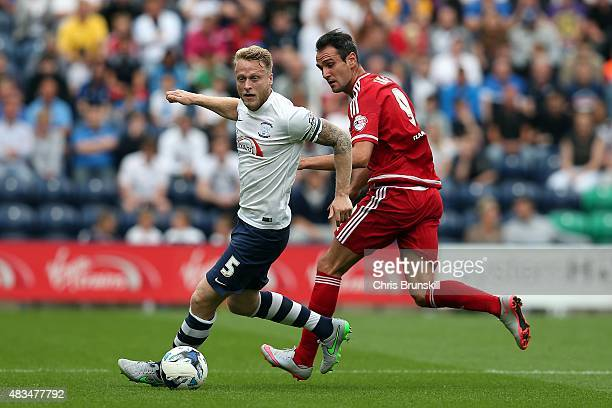 Tom Clarke of Preston North End in action with Kike of Middlesbrough during the Sky Bet Championship match between Preston North End and...