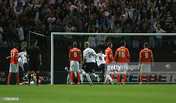 Tom Clarke of Preston North End scores the winning goal during the Capital One Cup first round match between Preston North End and Blackpool at...