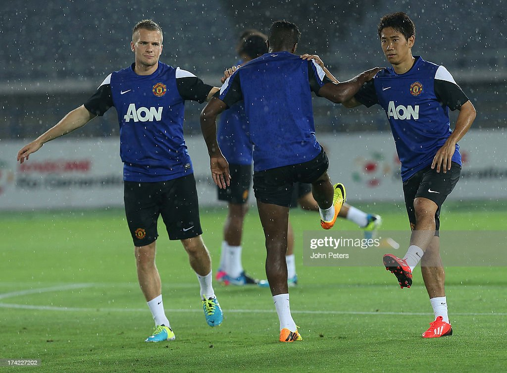 Tom Cleverley and Shinji Kagawa of Manchester United in action during a first team training session as part of their pre-season tour of Bangkok, Australia, China, Japan and Hong Kong on July 22, 2013 in Yokohama, Japan.