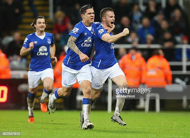 Tom Cleverley of Everton celebrates with team mate Muhamed Besic as he scores their first goal during the Barclays Premier League match between...