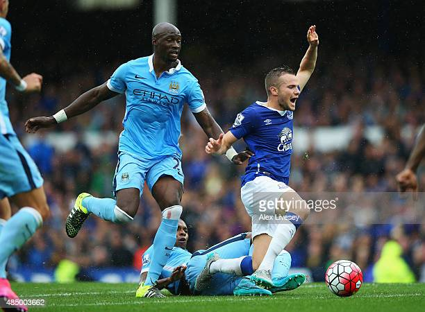 Tom Cleverley of Everton is challenged by Eliaquim Mangala of Manchester City during the Barclays Premier League match between Everton and Manchester...