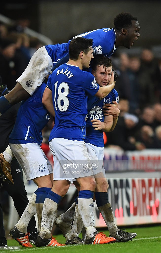 Tom Cleverley of Everton (R) is mobbed by team mates in celebration as he scores their first goal the Barclays Premier League match between Newcastle United and Everton at St James' Park on December 26, 2015 in Newcastle upon Tyne, England.