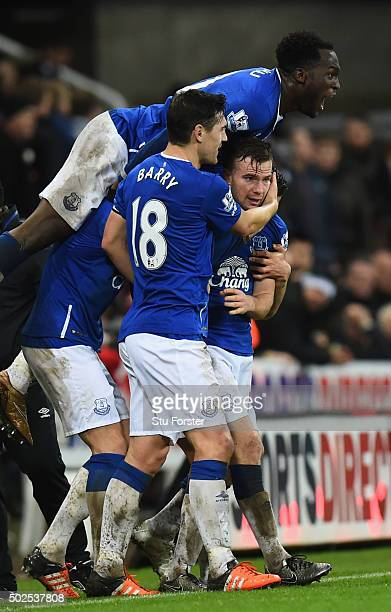 Tom Cleverley of Everton is mobbed by team mates in celebration as he scores their first goal the Barclays Premier League match between Newcastle...