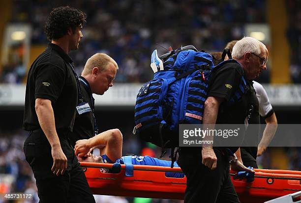Tom Cleverley of Everton is taken off the pitch by stretchers after picking up injury during the Barclays Premier League match between Tottenham...