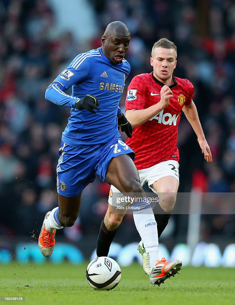 Tom Cleverley of Manchester United competes with Demba Ba of Chelsea during the FA Cup sponsored by Budweiser Sixth Round match between Manchester United and Chelsea at Old Trafford on March 10, 2013 in Manchester, England.