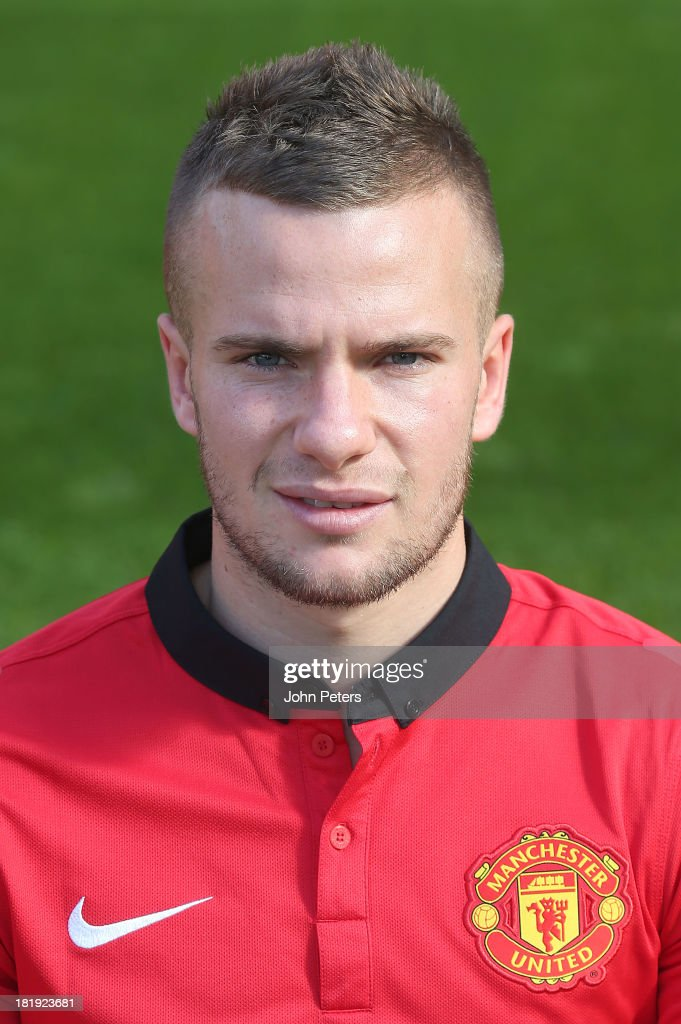 <a gi-track='captionPersonalityLinkClicked' href=/galleries/search?phrase=Tom+Cleverley&family=editorial&specificpeople=4192565 ng-click='$event.stopPropagation()'>Tom Cleverley</a> of Manchester United poses at the annual club photocall at Old Trafford on September 26, 2013 in Manchester, England.