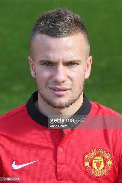 Tom Cleverley of Manchester United poses at the annual club photocall at Old Trafford on September 26 2013 in Manchester England