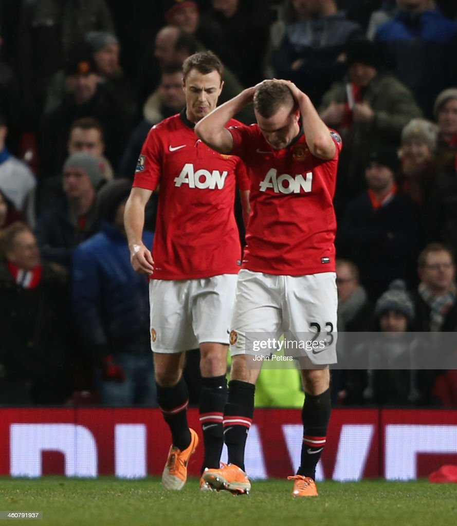 <a gi-track='captionPersonalityLinkClicked' href=/galleries/search?phrase=Tom+Cleverley&family=editorial&specificpeople=4192565 ng-click='$event.stopPropagation()'>Tom Cleverley</a> of Manchester United reacts to conceding a goal to <a gi-track='captionPersonalityLinkClicked' href=/galleries/search?phrase=Wilfried+Bony&family=editorial&specificpeople=4231248 ng-click='$event.stopPropagation()'>Wilfried Bony</a> of Swansea City during the FA Cup Third Round match between Manchester United and Swansea City at Old Trafford on January 5, 2014 in Manchester, England.