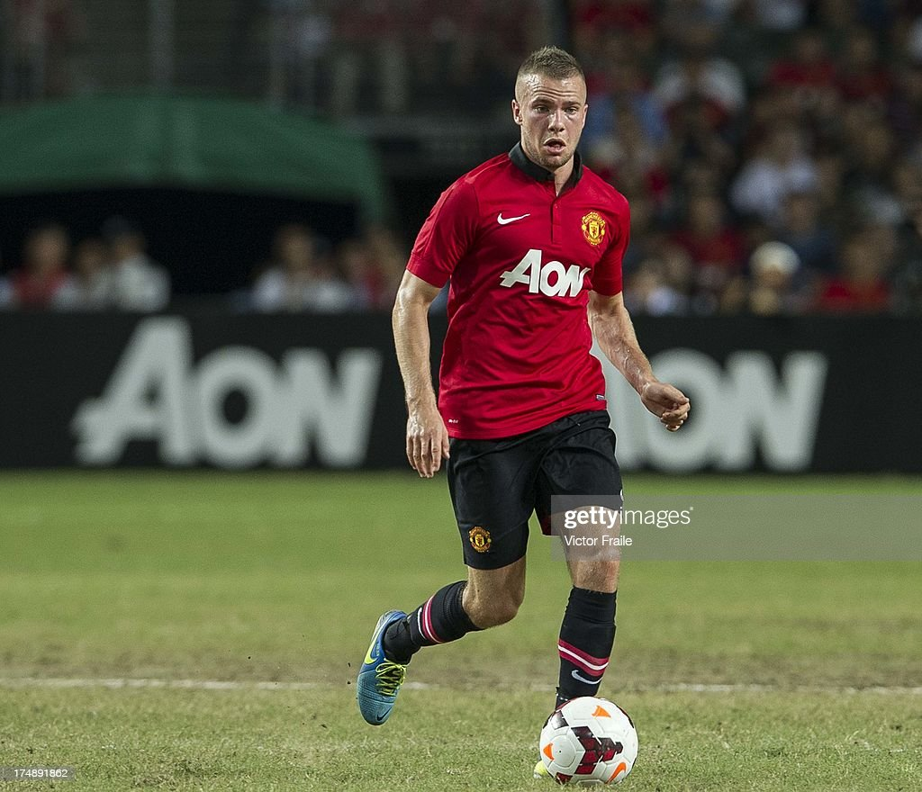 Tom Cleverley of Manchester United runs with the ball during the international friendly match between Kitchee FC and Manchester United at Hong Kong Stadium on July 29, 2013 in So Kon Po, Hong Kong.